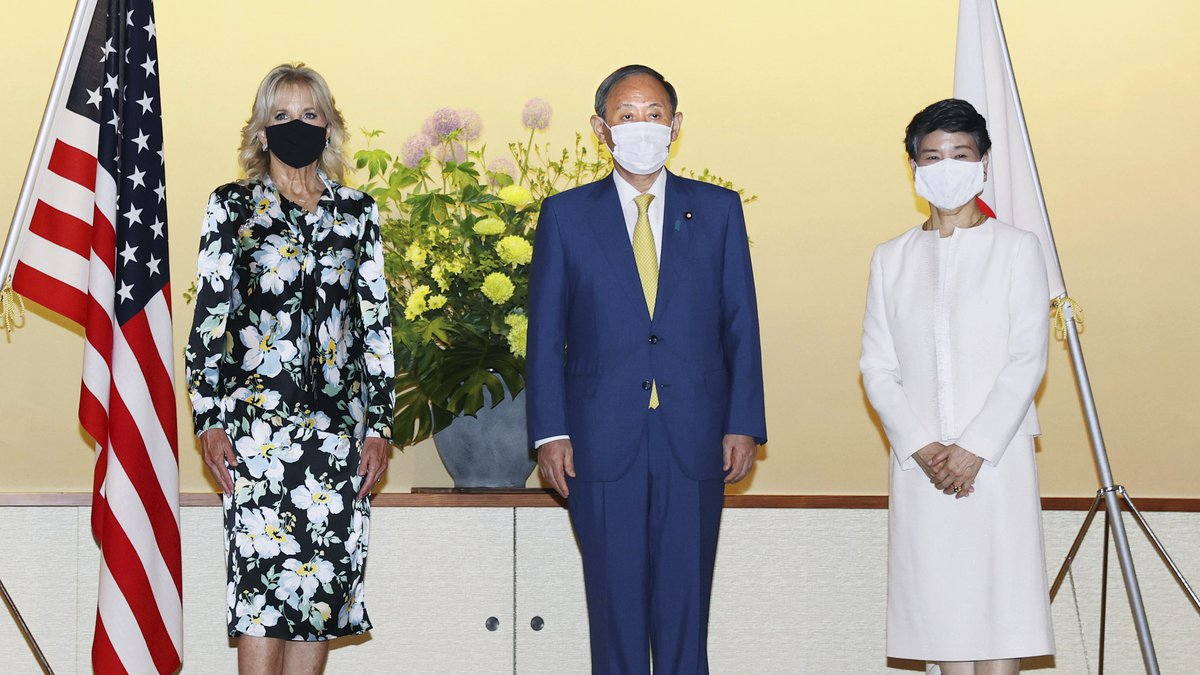 First lady of the U.S. Jill Biden poses for a photo with Japanese Prime Minister Yoshihide Suga...