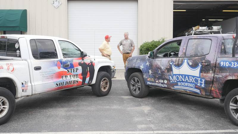 Rick Courtney, left, and Mike Fluhr chat outside Monarch Roofing headquarters Friday morning.