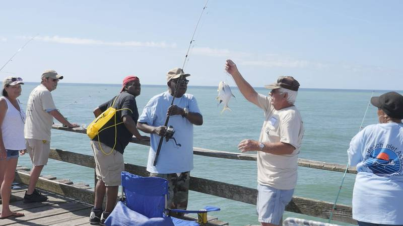 A fisherman reels in a pompano at Friday's Cape Fear Disabled Sportsman's Fishing Tournament on...