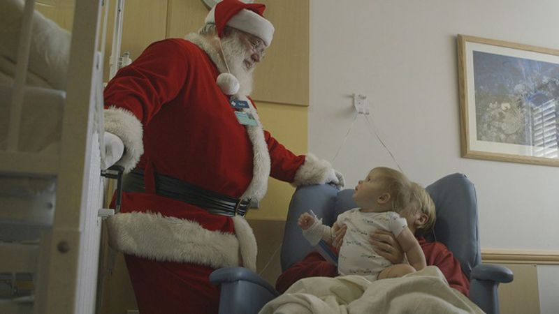 Santa visits with children at the NHRMC Pediatrics Unit before Christmas. (Source: WECT)