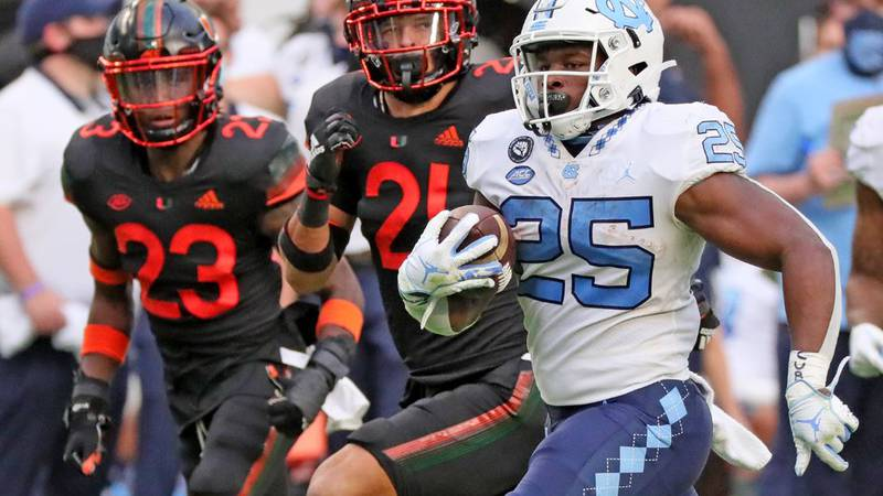Javonte Williams running for one of his 3 TD as the Heels embarrassed the Hurricanes 62-26.