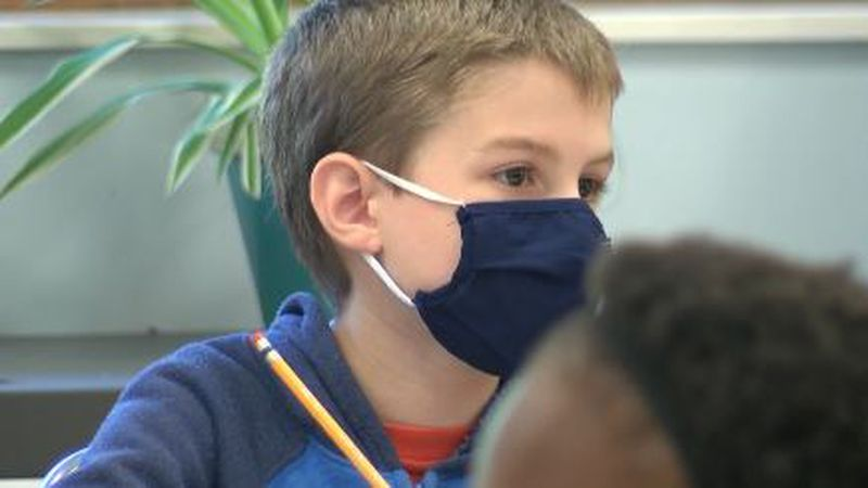 A student is wearing a mask while in class.