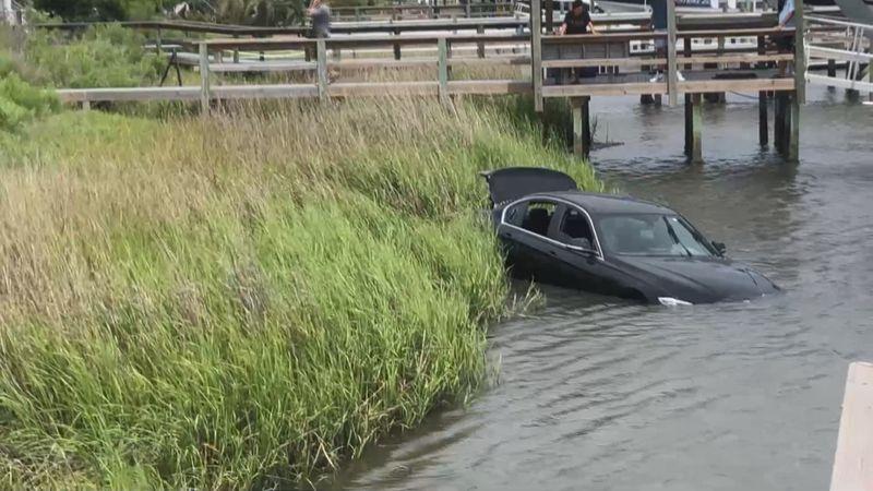 Crews pull car from Davis Canal Sunday