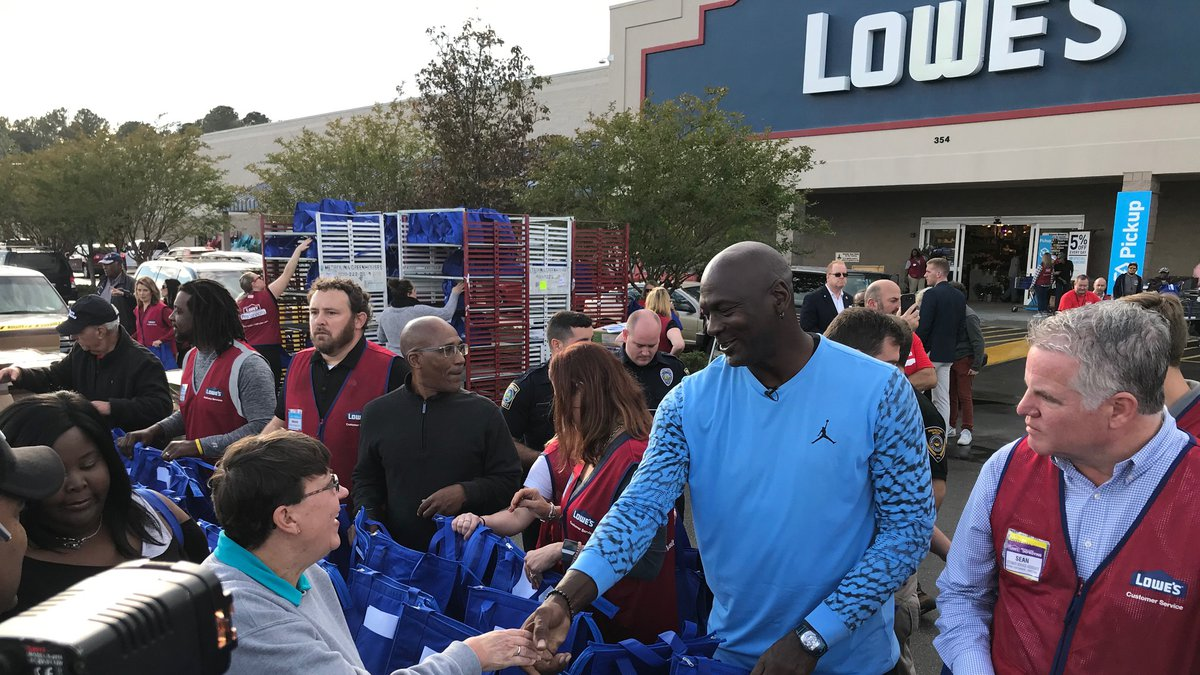 Michael Jordan helping to hand out Thanksgiving meals at the Lowe's Home Improvement in...