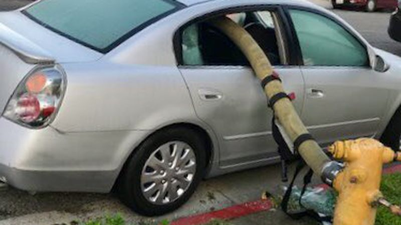 When firefighters found a car between them and the hydrant they needed water from, they broke...