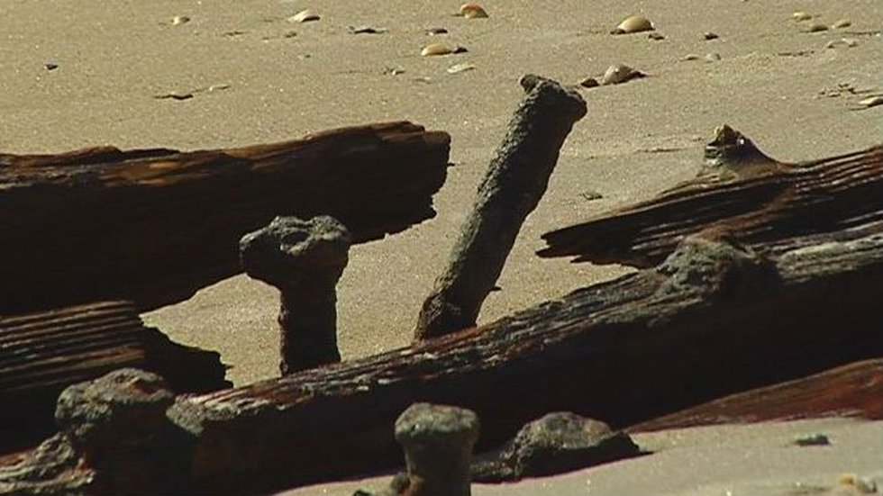 Pieces of wrecked ship uncovered again at Surf City