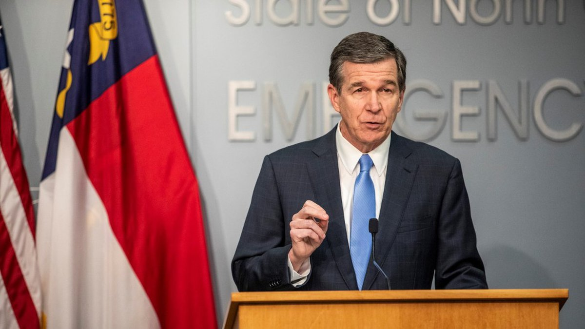 Gov. Roy Cooper signed a landmark energy measure for North Carolina that aims to dramatically...