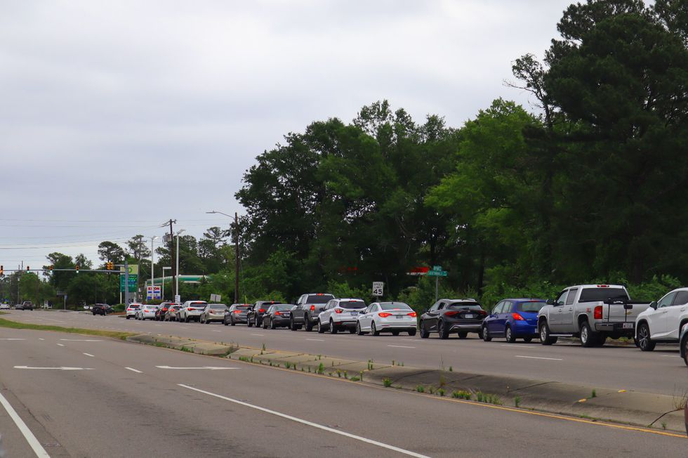 Long lines like these are being reported at numerous gas stations in Wilmington and surrounding...