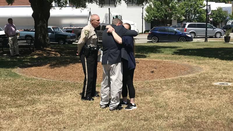 David Gore hugs Tara Thau, the girlfriend of Allen Blanchard, following Friday's sentencing.