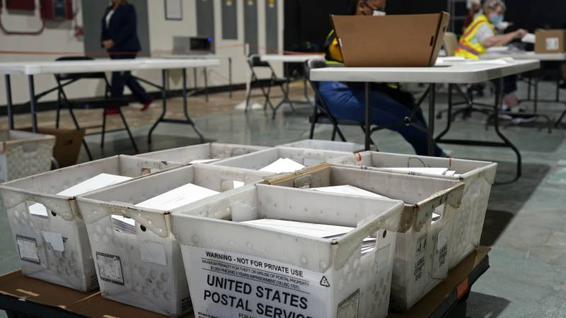 FILE - In this Sept. 3, 2020, file photo, workers prepare absentee ballots for mailing at the...