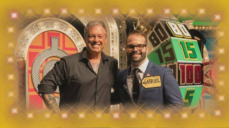 """WECT's Gabe Ross and """"The Price is Right Live!"""" host, Todd Newton, pose for a picture in front..."""