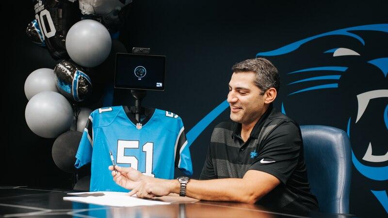 KP the robot and Samir Suleiman (Panthers' Director of Player Negotiations & Salary Cap...