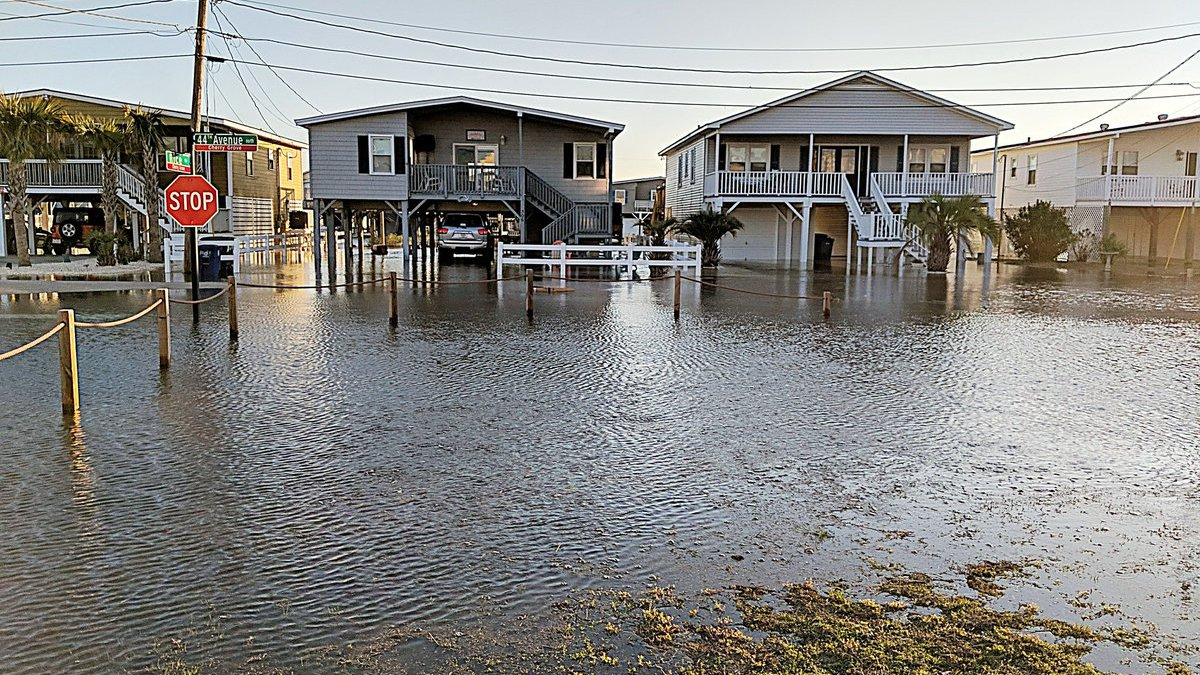A series of social media videos show extremely high tide along the streets of North Myrtle...