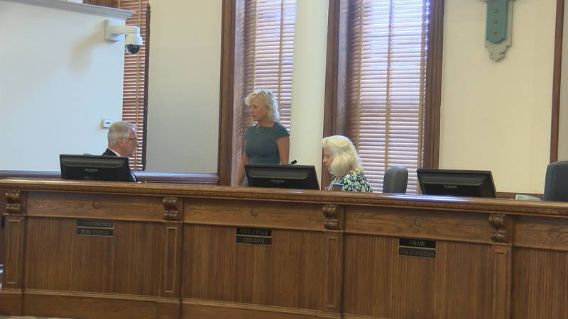 Commissioners pull controversial resolution singling out two members