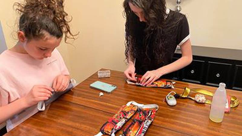 Madyson and Bella Evans making masks for first responders