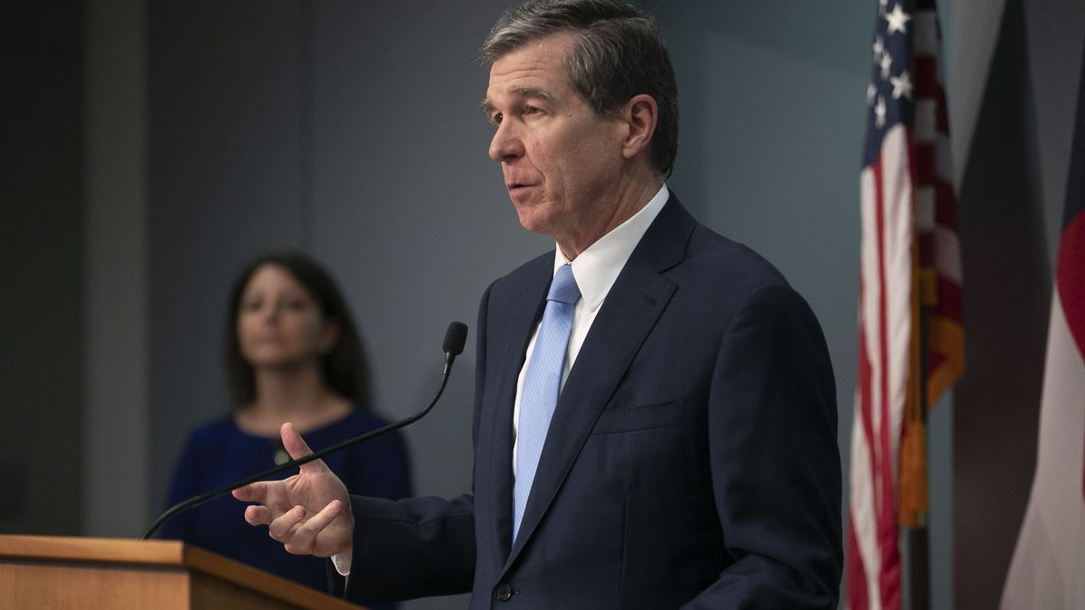 North Carolina Governor Roy Cooper updates the public during a press briefing on the COVID-19...