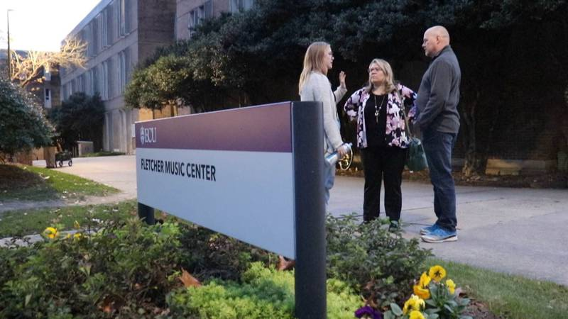 Mikayla Luke, left, talks with her parents, Jim and Theresa Luke, on the campus of East...