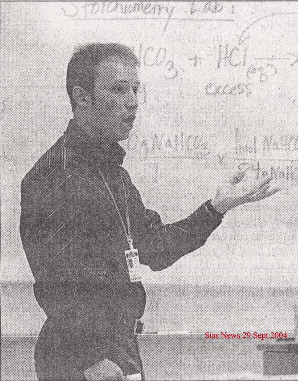 A yearbook photo shows Michael Kelly in his classroom in 2004.