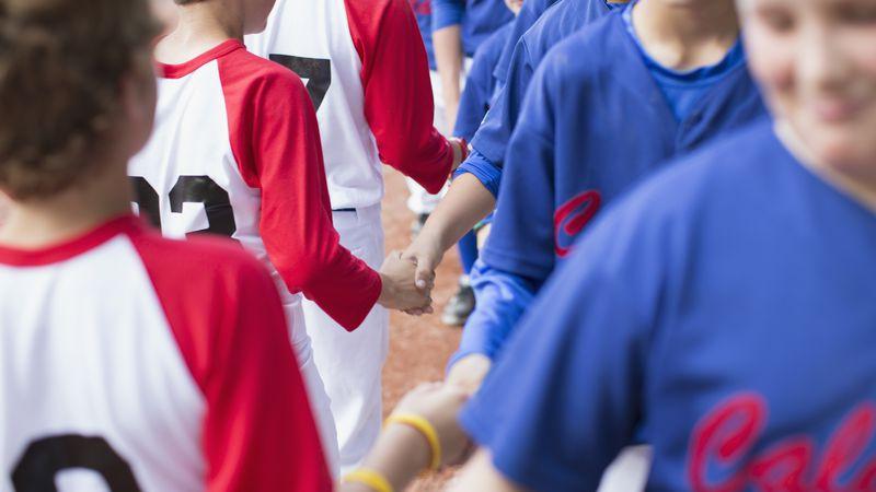 boys baseball teams shaking hands after game