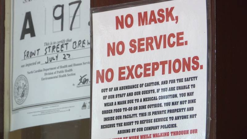 Front Street Brewery requires masks to be worn while walking through the facility and...