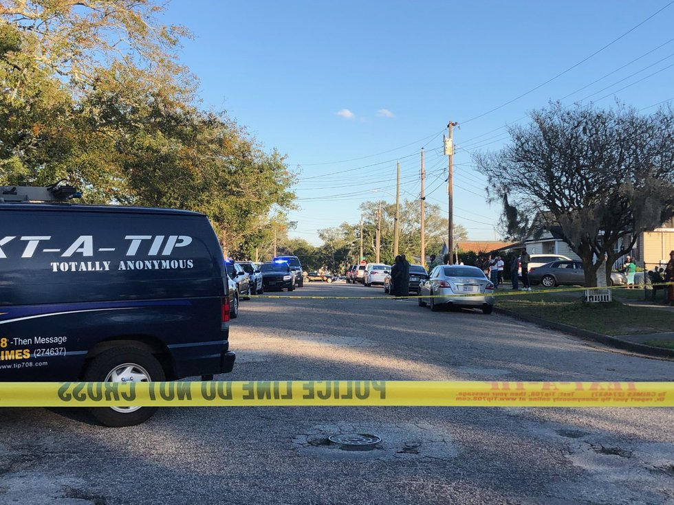 Police investigate a crime scene on 12th Street Friday afternoon.