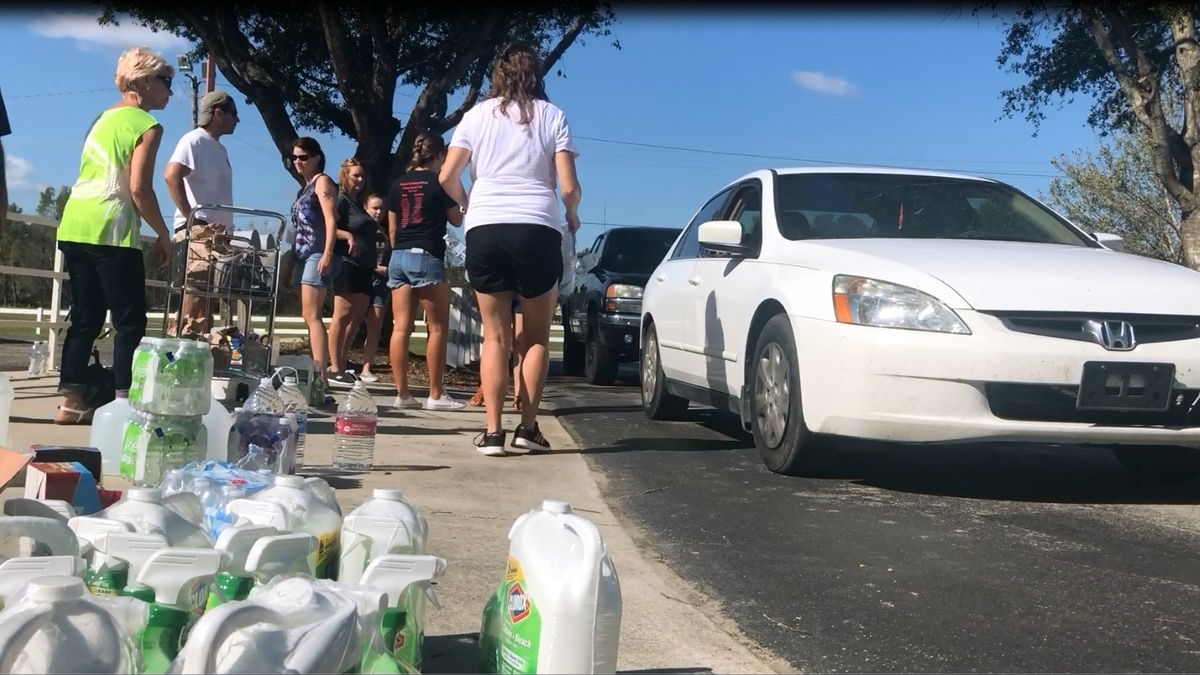 Lincoln elementary staff passing out relief supplies for Hurricane Florence. (Source: WECT)