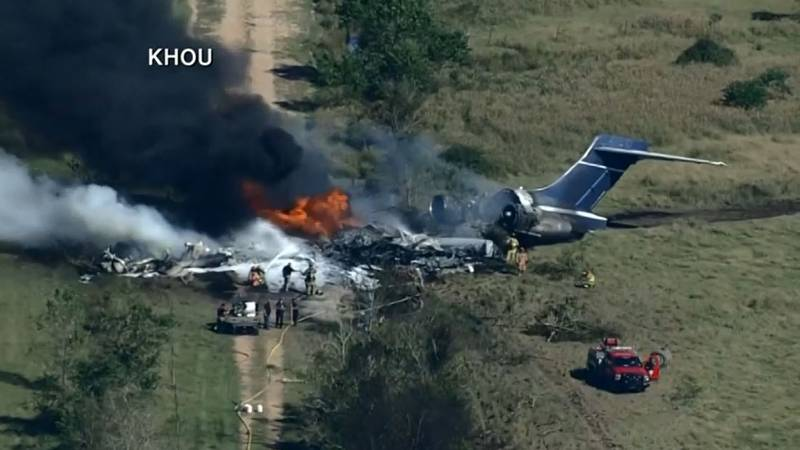 The crash site appears to be a field near the Houston Executive Airport. Firefighter are...