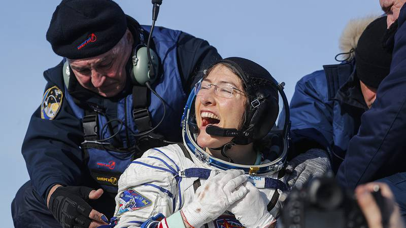 U.S. astronaut Christina Koch reacts shortly after the landing of the Russian Soyuz MS-13 space...