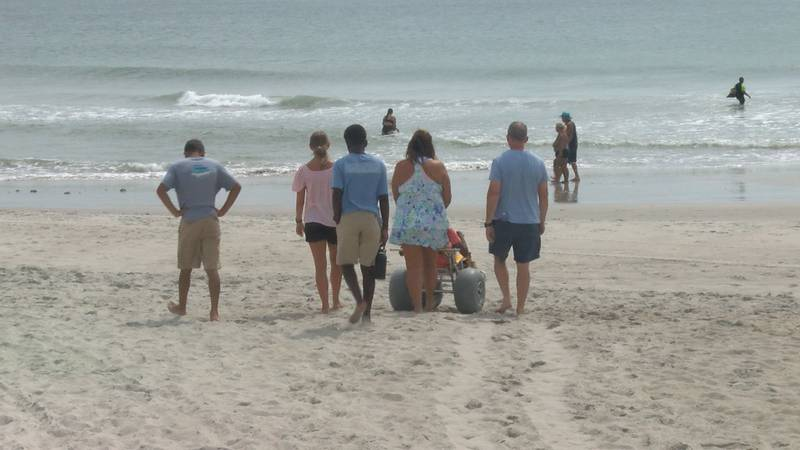 The McDaniel Family walks on the shores of Kure Beach everyday, including their son in his...