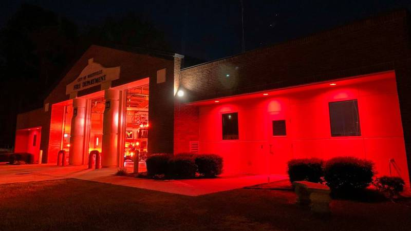 The fire department building, which is located at 120 E Columbus St., was bathed in red light...