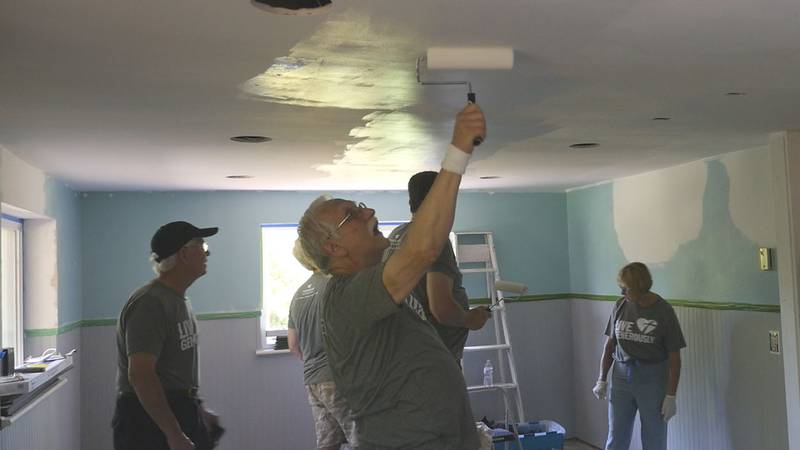 Orchard Lake (Mich.) Presbyterian Church missionaries paint the ground floor of Ruth Best's...