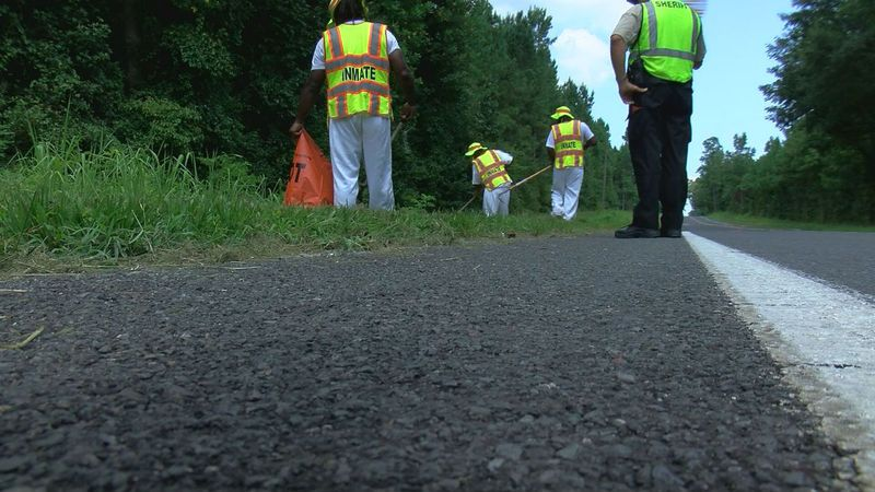 Each inmate participating in trash pick-up must volunteer and they are offered days off their...