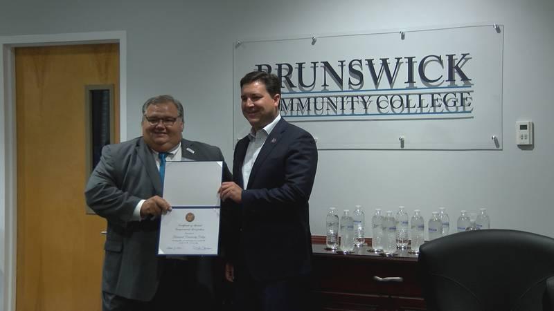 Representative David Rouzer (R-NC) presents the school with a certificate