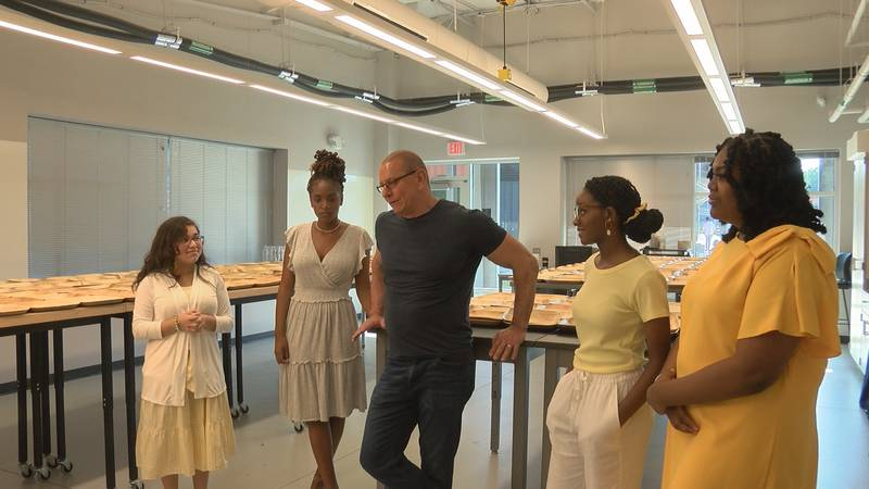 Chef Robert Irvine speaks with GLOW Academy students at the fundraiser Friday.