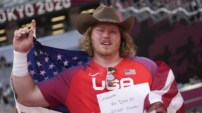 Ryan Crouser, of United States, celebrates after winning the final of the men's shot put at the...