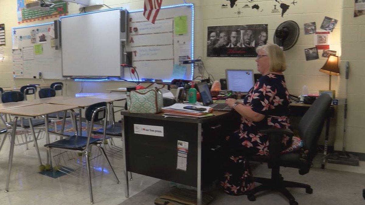 Sixth grade social studies teacher Leslie Neilsen works at her desk at Community House Middle...