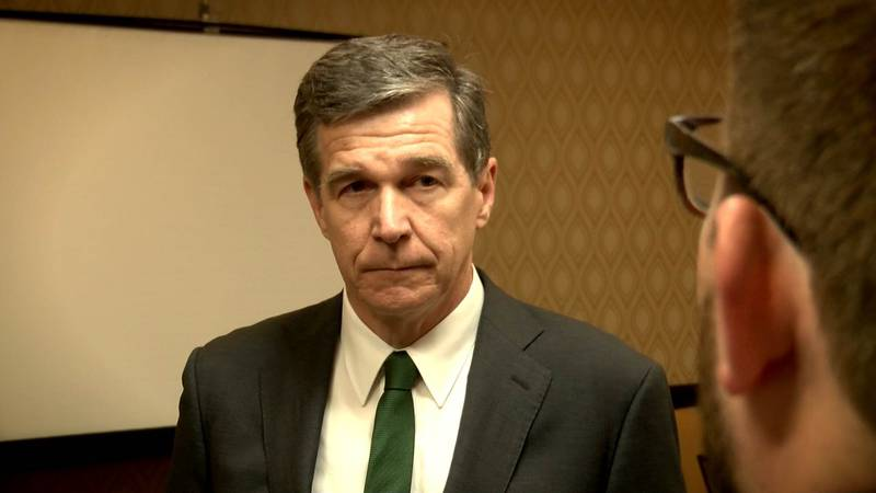 Governor Roy Cooper listens to a question from WBTV's Chief Investigative Reporter Nick Ochsner...