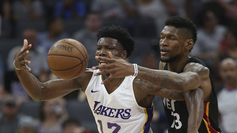 Los Angeles Lakers forward Devontae Cacok, left, and Miami Heat forward Chris Silva go for the...