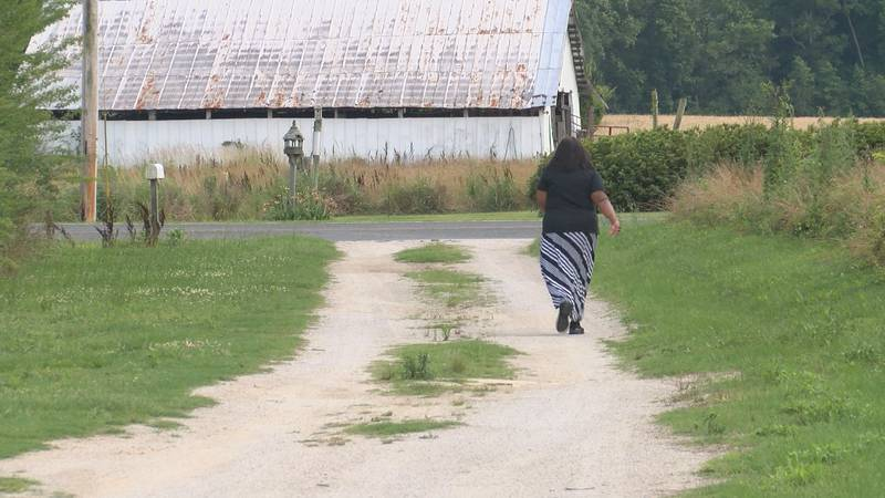 Sheila Johnson walks down her driveway to exercise, something she starting doing after her...