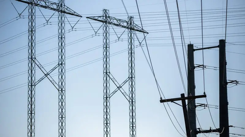 Electrical power lines in Del Valle. Power demand is expected to break an all-time record...