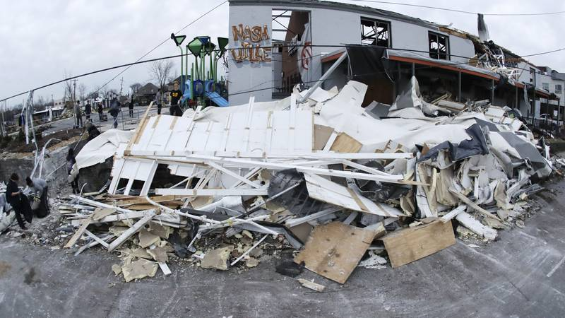 Debris is piled up by a damaged business Wednesday, March 4, 2020, in Nashville, Tenn....