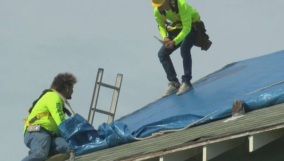 Roofing companies are slammed after Florence and ahead of Michael