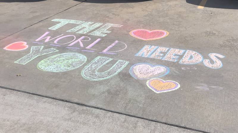 Supportive messages written in sidewalk chalk for staff at one Heartland hospital