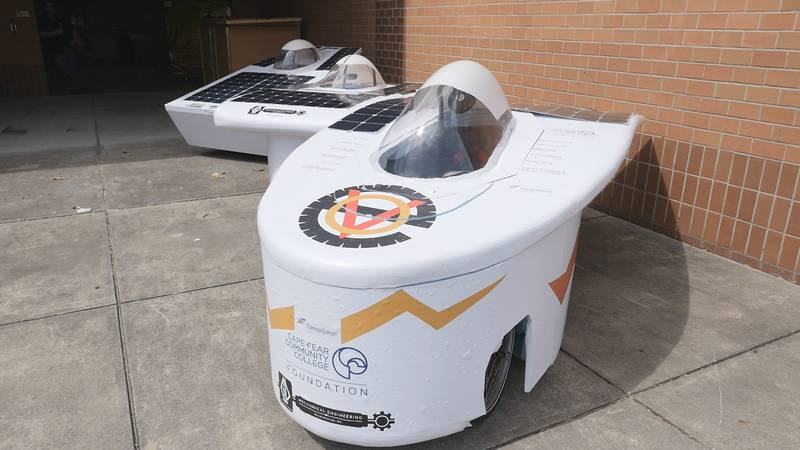 Three of the four solar powered cars built by Cape Fear Community College students are lined up...