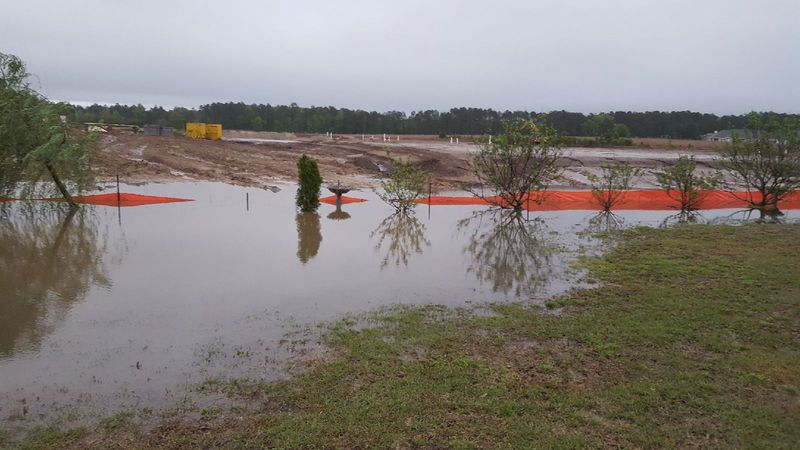 Neighbors in Carolina Shores woke up to their yards flooded Tuesday morning. (Source: Teresa...