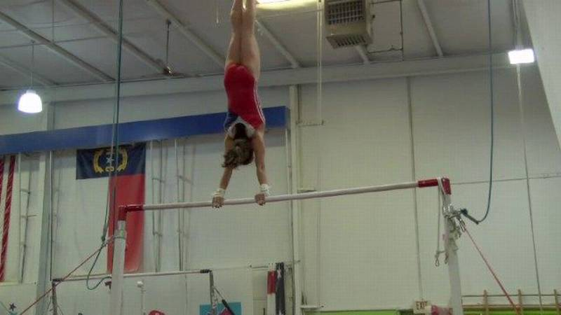 RAW: Emily Schild shows off her uneven bars routine
