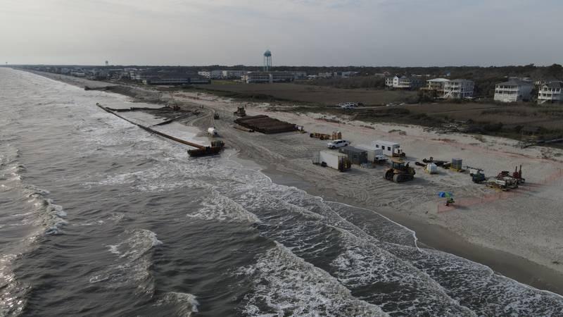Oak Island works to complete beach renourishment project.