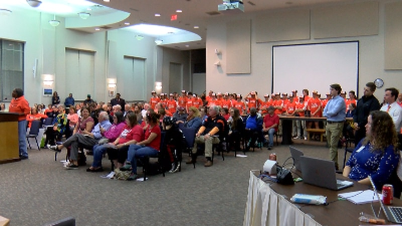 Sea of Orange in support of Richard Foy at NHCBOE meeting.