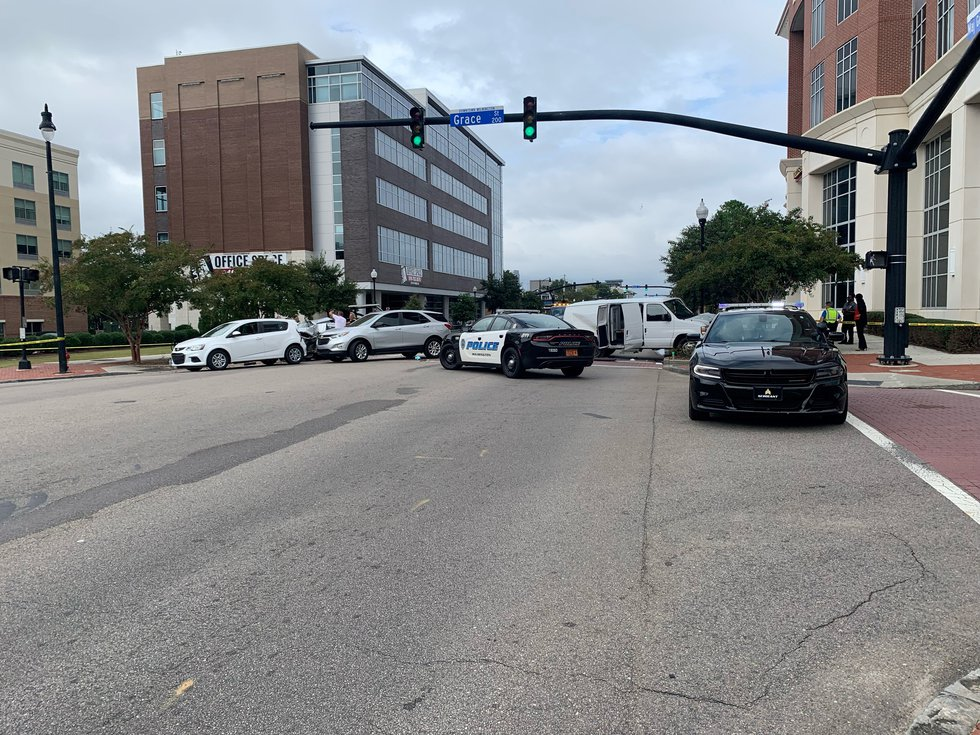 At least two people were injured in a six-vehicle crash in downtown Wilmington Friday afternoon.