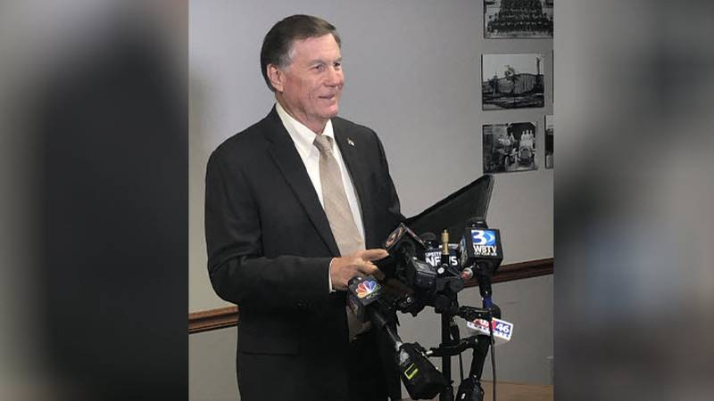 NC Insurance Commissioner Mike Causey addresses the media regarding his call for the CEO of...